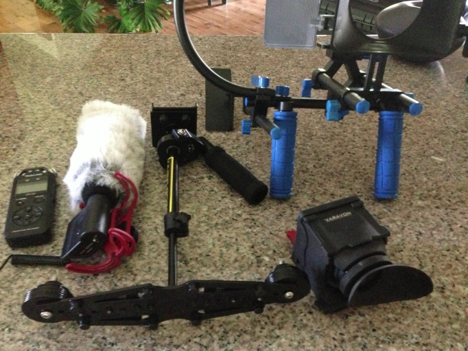 Some of the video gear I'll be taking with me to the arctic. From left to right - Rode video microphone, Glidecam camera stabilizer, Varavon multi-finder viewfinder, shoulder video rig stabilizer.