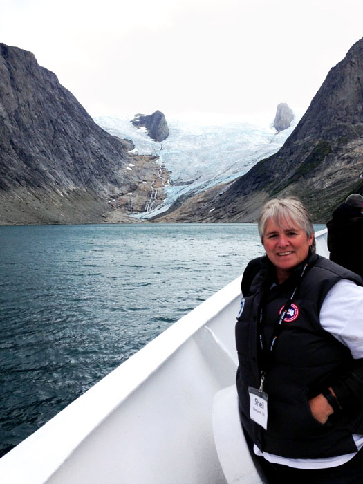 Me, aboard the Sea Adventurer, with a massie glacier in the background. Our wonderful ship's captain took us down some of the most incredible fjords in Greenland.